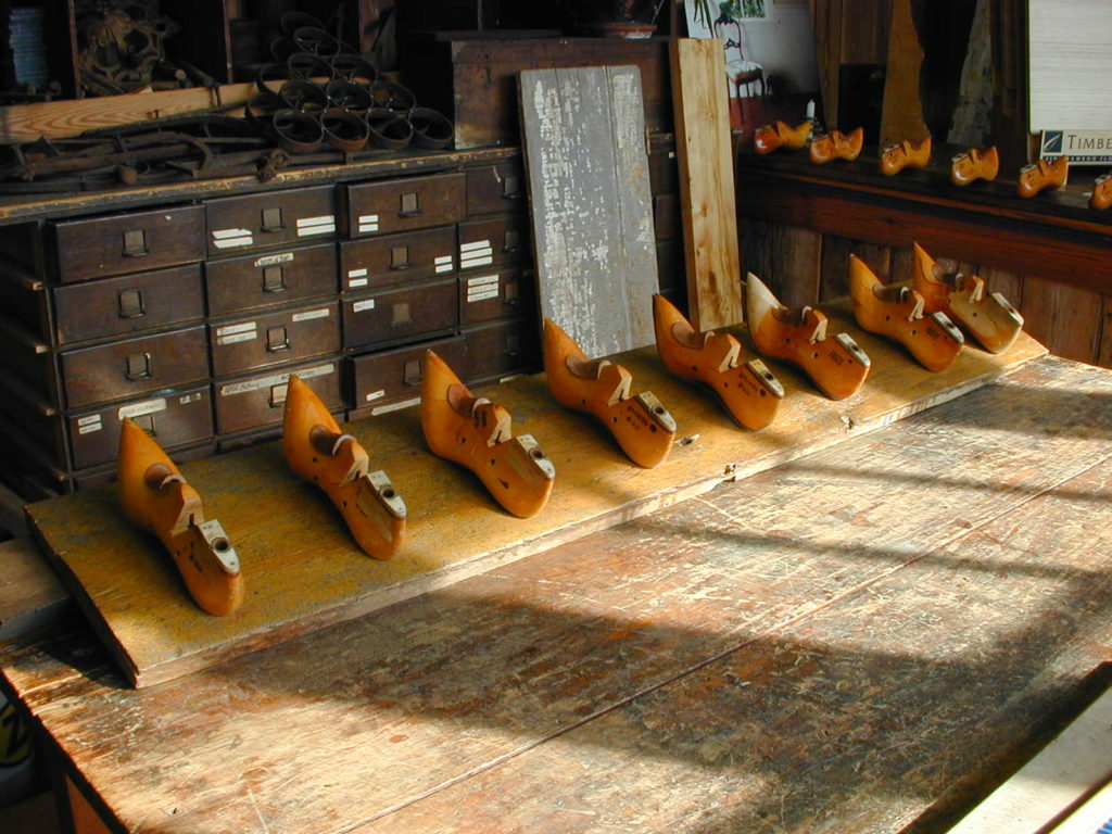 A coat rack made from antique shoe lasts salvaged from a mill in Lawrence, Massachusetts.