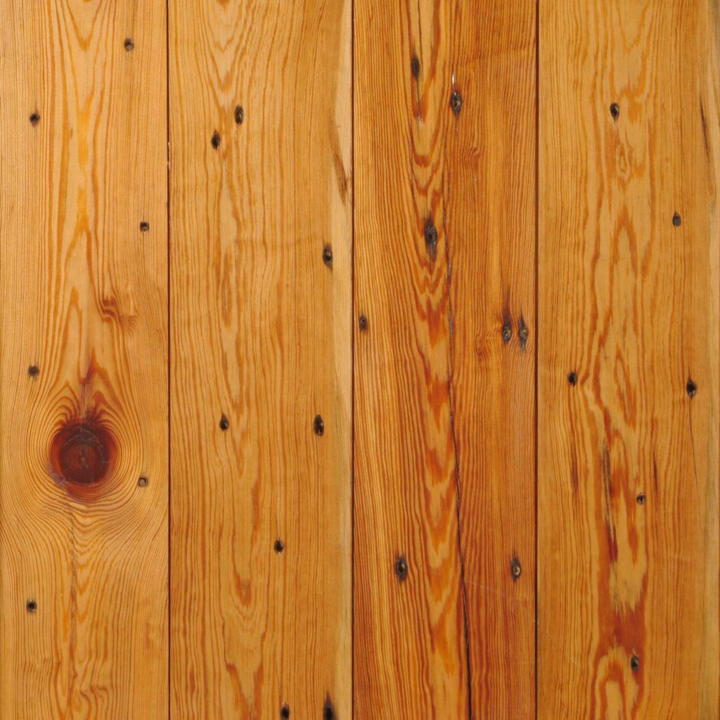 Reclaimed Naily Buckshot Tongue-And-Groove Heart Pine Flooring. Waterlox Tung Oil Finish.