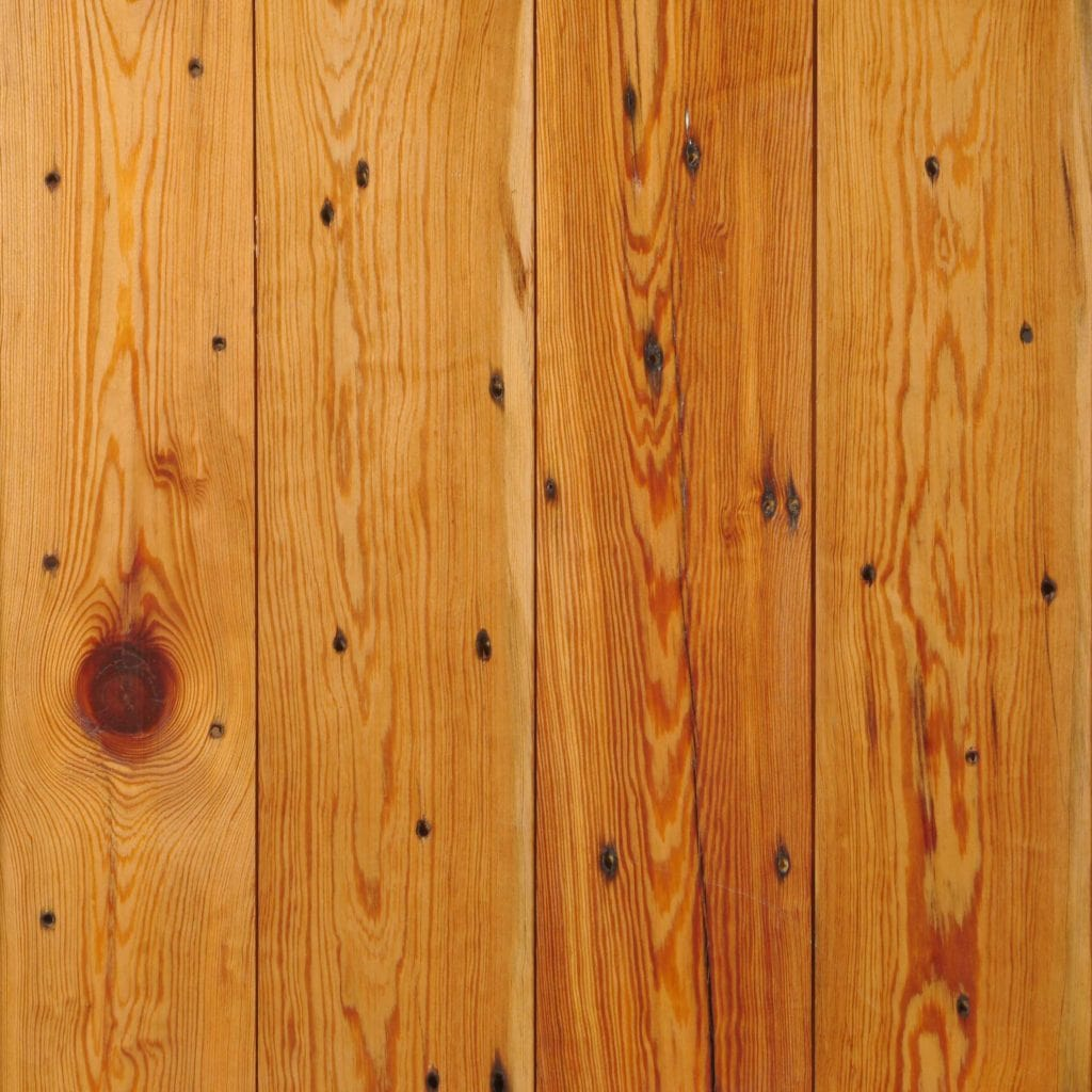 Reclaimed Naily Buckshot Heart Pine flooring, milled in tongue-and-groove style.