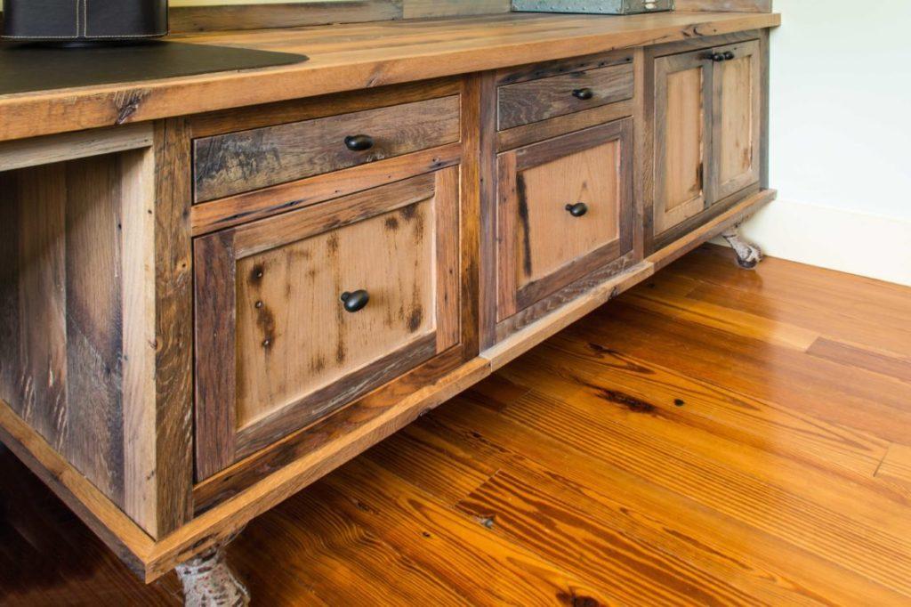 Reclaimed skip-planed oak cabinets by Hawkeye Carpentry.