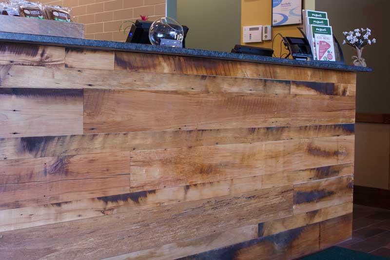 Restaurant Reclaimed Skip-Planed Mixed Hardwoods Paneling in Attleboro, MA. Finished with Water-Based Polyurethane.