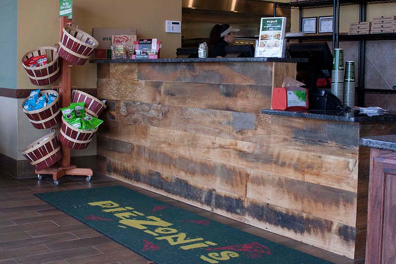 PieZoni's Restaurant Reclaimed Skip-Planed Mixed Hardwoods Paneling in Franklin, MA. Finished with Water-Based