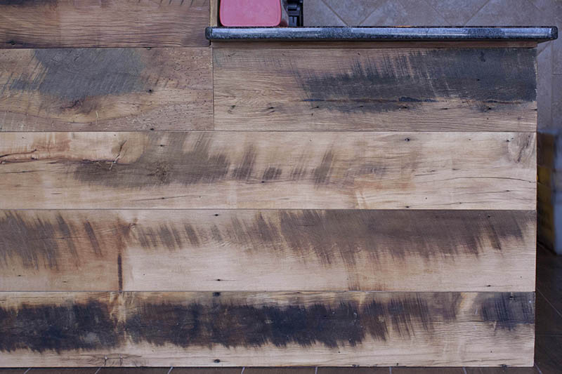 Reclaimed Skip-Planed Mixed Hardwoods Paneling in Franklin, MA. Finished with Water-Based Polyurethane.