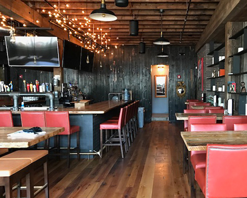 Reclaimed Wood Bar Top, Tables and Charred Wood Paneling at Brick & Beam Tavern in Quincy, MA