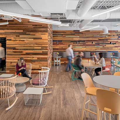 Reclaimed Wood Paneling on Walls in Workspace Cafeteria